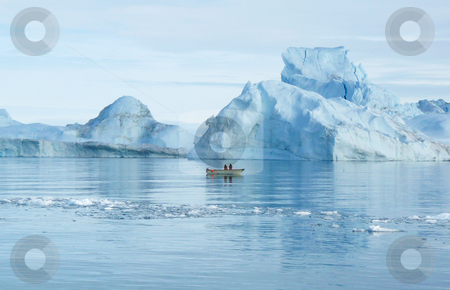 Fishing near Icebergs stock photo, Two men in a small boat, checking their catch in the shadow of the icebergs by Helen Shorey