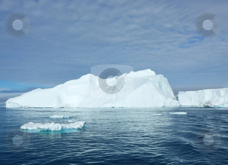 Icebergs with Cracks stock photo, Large cracked iceberg with some smaller ones in the foreground - Greenland seas by Helen Shorey