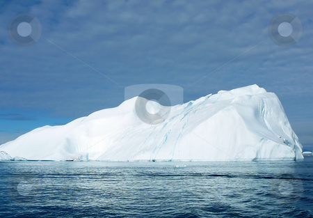 Cracking Iceberg 4 stock photo, Large iceberg showing crevasses/cracks. off the coast of Greenland by Helen Shorey