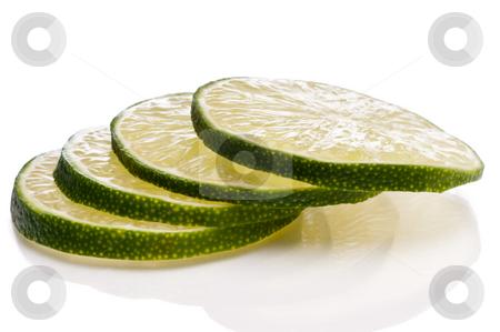 A horizontal close-up of juicy fresh cut lime slices. stock photo, A horizontal close-up of juicy fresh cut lime slices. by Vince Clements