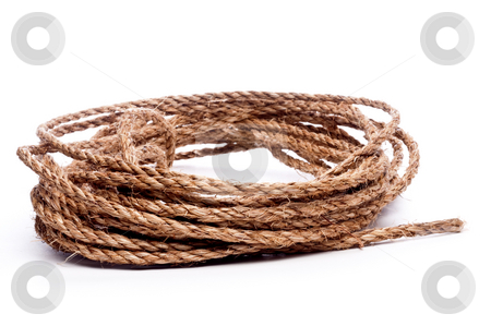 A horizontal view of a coil of rope on white  stock photo, A horizontal view of a coil of rope on white by Vince Clements