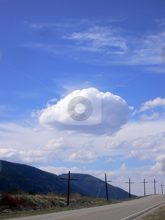 Clouds and Mountains stock photo, Image featuring a view of the mountains and clouds from the shoulder of the road. by JJ Havens