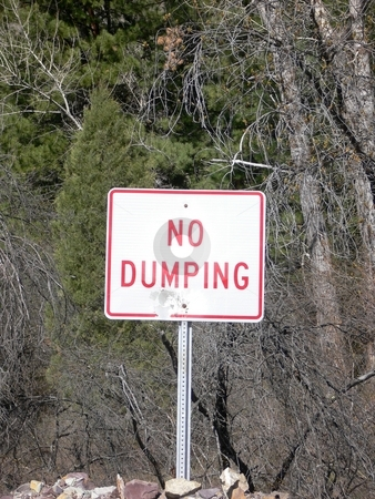 No Dumping Sign stock photo, No dumping sign, sign normally used to keep people from dumping in a certain area. by JJ Havens