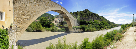 Medieval Bridge stock photo, The Medieval bridge over the river Eygues in Nyons, Drome en Provence, completed in 1407, with a single span of 40,5 meters by Corepics VOF