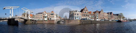 Haarlem skyline stock photo, A 180 degrees panoramic view over the Spaarne, with the old city center of Haarlem, it's old houses, the Teylers' Museum, and the classic draw bridge across the canal. This stitch has been made out of 34 images by Corepics VOF