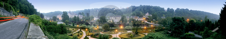 Durbuy Skyline stock photo, The skyline of the smallest city in Europe, Durbuy, in the Belgian Ardennes, with its picturesque castle and the ornamental garden in front, separated by the river Ourthe on a hazy, damp evening.