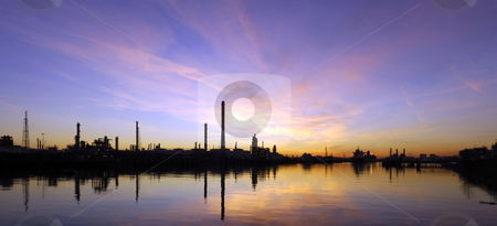 Oil Refinary at sunset stock photo, An oil refinary at sunset, situated in an industrial harbor area, with its piers, jetties and mooring buoys. by Corepics VOF