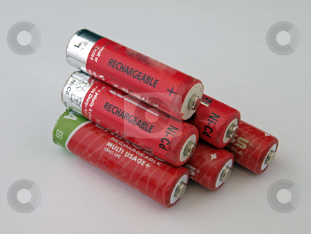 Six rechargeable batteries. stock photo, Six used size  AA red rechargeable batteries. by Ian Langley