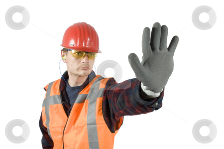 Stop stock photo, A construction worker wearing protective work wear for safety: a hard top, ear plugs goggels and protective gloves giving a stop sign with his hand by Corepics VOF