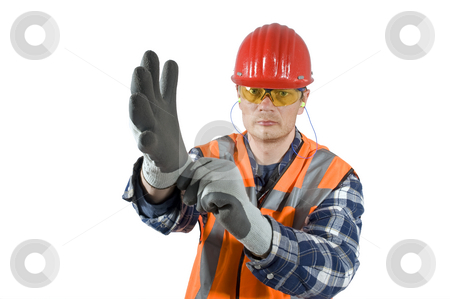 Putting on gloves stock photo, A worker, demonstratively putting on his safety gloves. Clipping path included by Corepics VOF
