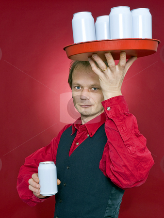 Serving you stock photo, A waiter with a tray of beverage cans above his head holding out one can in his outstetched hand to a customer by Corepics VOF