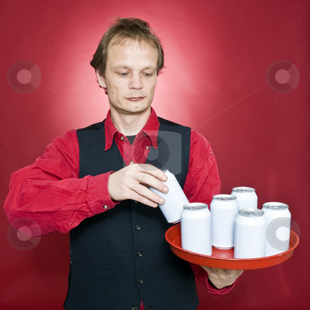 Putting cans on a tray stock photo, A waiter placing beverage cans on a tray by Corepics VOF