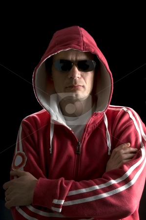 Hoodlum stock photo, A grim looking Hoodlum wearing sunglasses by Corepics VOF