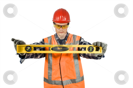 Keeping it Level stock photo, A construction worker holding a level horizontal, clipping path included by Corepics VOF