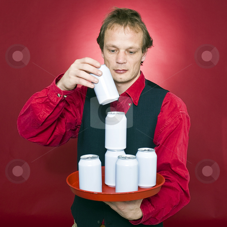 Stacking cans stock photo, A waiter stacking cans on a tray by Corepics VOF