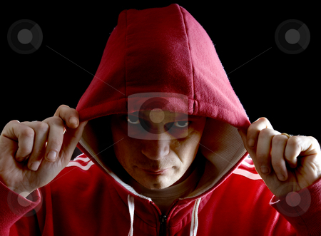 Hoodlum stock photo, A mean looking man wearing a hoodie by Corepics VOF