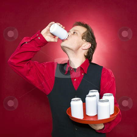 Thirsty waiter stock photo, A waiter, holding a tray with blank cans seeking refreshment and drinking by Corepics VOF