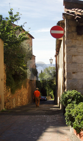 Path in Tuscany stock photo, Man walking down street in Tuscany by Jaime Pharr
