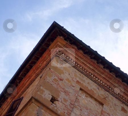 Building corner stock photo, Looking up at the corner of a building in Tuscany by Jaime Pharr