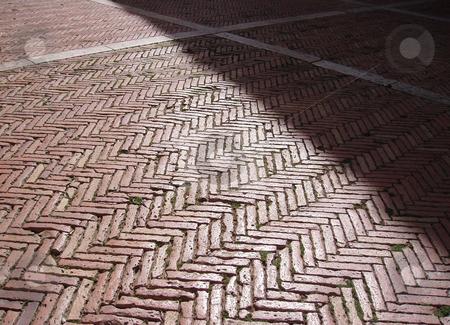 Sunlit walkway stock photo, Sunlit brick walkway with white stripes by Jaime Pharr