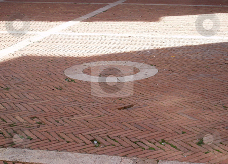 Sunlit piazza brick stock photo, Sunlit brick ground in Tuscan piazza by Jaime Pharr