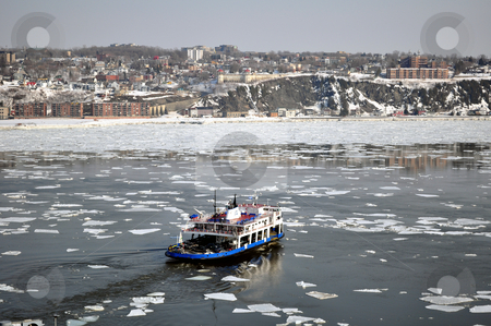 Transportation: Ferry boat stock photo, Transportation: Ferry boat crossing river in winter by Fernando Barozza
