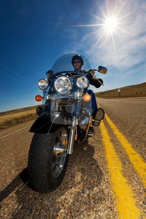 Sunny ride stock photo, A biker enjoying a ride in the country side on a sunny day by Steve Mcsweeny