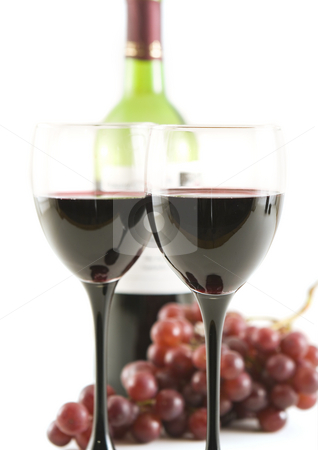 Wine and grapes stock photo, Glasses with red wine and grapes(shallow dof) by Steve Mcsweeny
