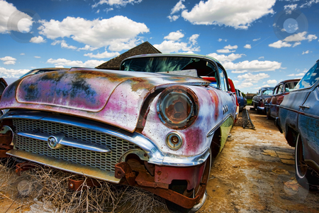 Old abandoned cars stock photo, Old abandoned vintage cars rusting in a ghost town by Steve Mcsweeny