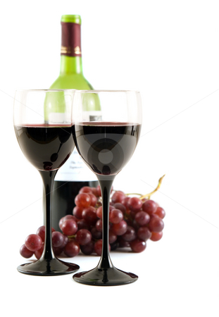 Red wine and grapes stock photo, Two glasses of red wine with grapes by Steve Mcsweeny