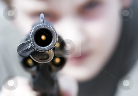 Violence stock photo, Loaded gun aimed at you, focus on gun barrel (shallow dof) by Steve Mcsweeny