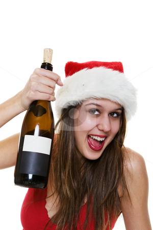 Christmas cheer stock photo, Happy woman in a santa hat holding a bottle of wine by Steve Mcsweeny