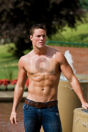 Athletic male model stock photo, A fit male model outside beside a water fountain by Steve Mcsweeny