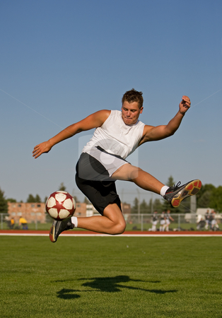 Soccer trick shot stock photo, Athletic male in the air making a trick shot by Steve Mcsweeny