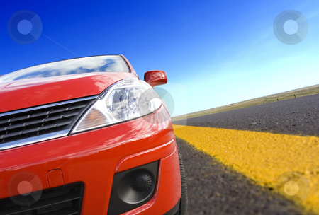 Car travel stock photo, Red car on a  rural road with yellow line by Steve Mcsweeny