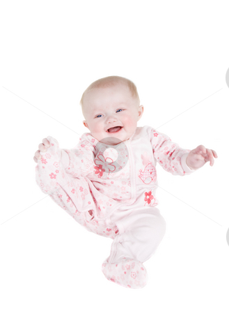 Happy baby stock photo, A happy baby playing with her Pajamas foot(high key) by Steve Mcsweeny