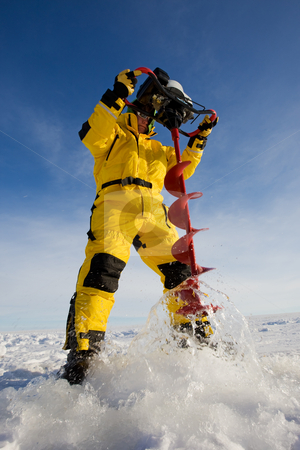 Drilling a hole stock photo, Ice fisherman drilling a hole with a power auger by Steve Mcsweeny