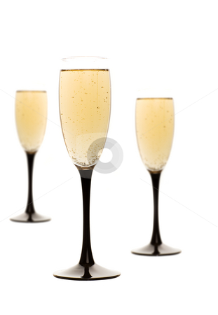Champagne drinks stock photo, Three champagne glasses isolated on white with focus on front glass by Steve Mcsweeny