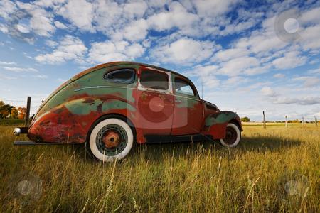Old vintage car stock photo, Old Vintage car rusting in a prairie field by Steve Mcsweeny