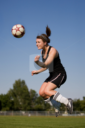 Woman soccer player stock photo, A female soccer player heading the ball by Steve Mcsweeny