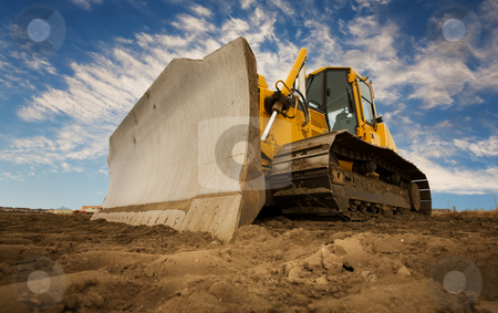 Bulldozer stock photo, A large yellow bulldozer at a construction site low angle view by Steve Mcsweeny