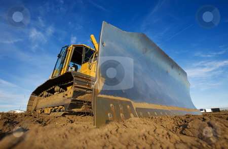 Yellow bulldozer stock photo, A large yellow bulldozer at a constuction site by Steve Mcsweeny