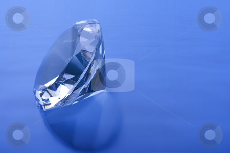 Diamond blue stock photo, Diamond on a blue wave background by Steve Mcsweeny