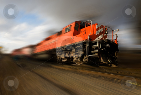 Speeding locomotive stock photo, A runaway freight train with wheels of the ground (added motion blur) by Steve Mcsweeny