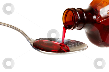 Cough syrup stock photo, A bottle of cold medicine poured into a spoon by Steve Mcsweeny