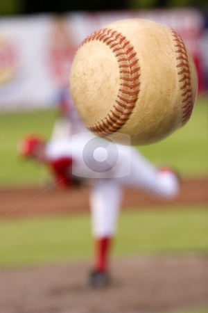 The pitch stock photo, A baseball player pitching with spin on the ball. (motion blur on ball) by Steve Mcsweeny