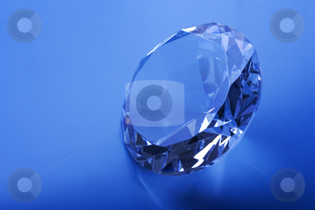 Sparkle stock photo, Diamond on a blue background by Steve Mcsweeny