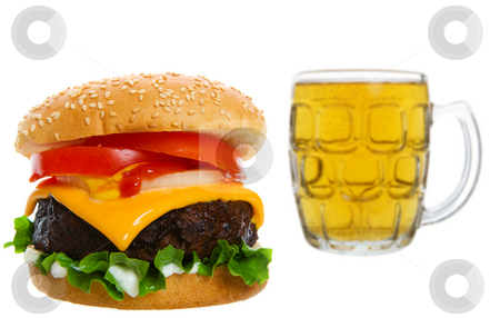 Cheeseburger with beer stock photo, Big Juicy cheese burger with  beer in the background by Steve Mcsweeny
