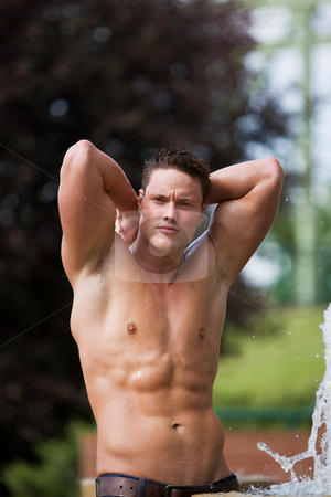 Healthy male stock photo, A male model outside beside a water fountain by Steve Mcsweeny