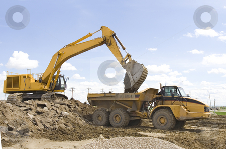 Construction stock photo, A hoe filling up a dump truck by Steve Mcsweeny